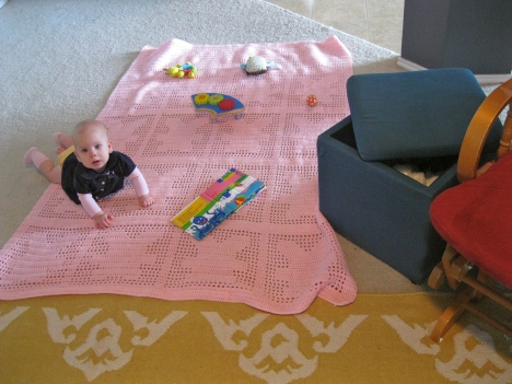 ottoman in living room baby toys